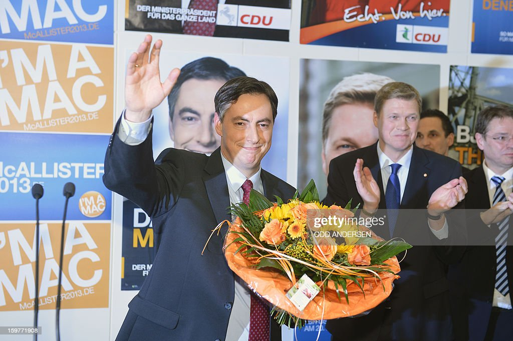 State premier of Lower Saxony David McAllister, waves to supporters at the CDU elections HQ at the Landtag regional parliament in Hanover on January 20, 2013 on polling day of the local elections in the central German state of Lower Saxony. The vote is largely seen as a test run for Chancellor Angela Merkel, her rivals and would-be heirs, eight months before nationwide polls. German Chancellor Angela Merkel's party was ahead after the first state poll in a general election year, exit polls indicated, but it was unclear whether its coalition would cling to power.