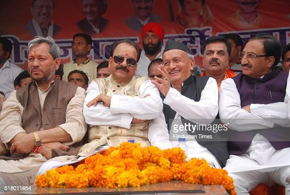 BJP state President Ajay Bhatt BJP MP Bhagat Singh Koshiyari and BJP MP from Haridwar Ramesh Pokhriyal Nishank druing the welcome ceremony of BJP...