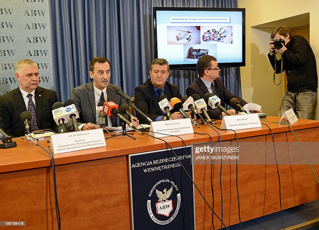 State prosecutors Mariusz Krason (2ndL), Artur Wona (3rdL) and Internal Security Agency official Jan Bilkiewicz (L) hold a press conference about the detention of a man who had plotted a car bomb attack on country's parliament, prime minister and president in Warsaw on November 20, 2012. He is believed to have been motivated by nationalist, xenophobic anti-Semitic beliefs and was found to be in possession of TNT, gunpowder and other explosives.Poland's domestic security agency said Tuesday it had detained a man suspected of plotting a car bomb attack on the country's parliament, prime minister and president. AFP PHOTO/JANEK SKARZYNSKI