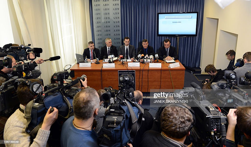 State prosecutors Mariusz Krason (3rdL), Artur Wona (2ndR) and Internal Security Agency officials maciej Karczynski (L) and Jan Bilkiewicz (2ndL) hold a press conference about the detention of a man who had plotted a car bomb attack on country's parliament, prime minister and president in Warsaw on November 20, 2012. He is believed to have been motivated by nationalist, xenophobic anti-Semitic beliefs and was found to be in possession of TNT, gunpowder and other explosives.Poland's domestic security agency said Tuesday it had detained a man suspected of plotting a car bomb attack on the country's parliament, prime minister and president.