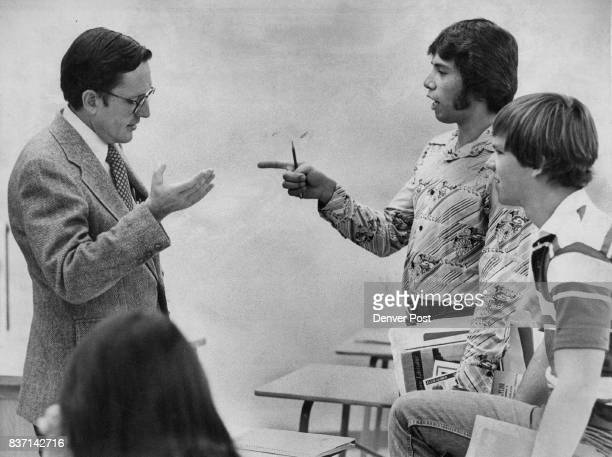 State Rep Frank Traylor RColo discusses problems of welfare with Randy Quintana a senior at Jefferson High School during the school's first Political...