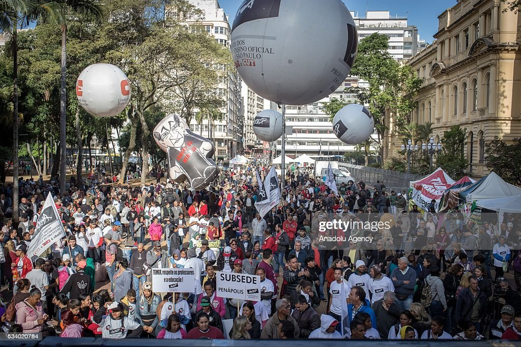 State school teachers display a balloon with the face of the Governor of Sao Paolo Geraldo Alckmin as they stage a protest demanding equal payment and better work conditions in Sao Paolo, Brazil on May 24, 2016. Most state teachers support the government the president away because of the impeachment process, Dilma Rousseff and protested against the government of interim president Michel Temer.