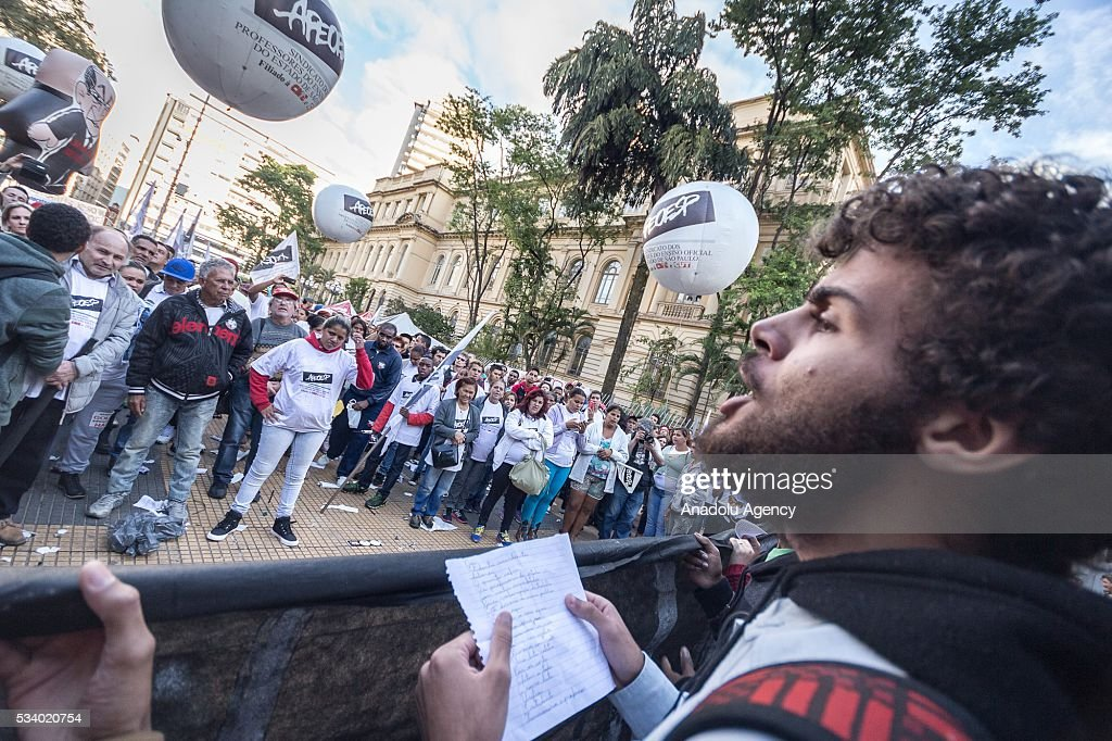 State school teachers stage a protest demanding equal payment and better work conditions in Sao Paolo, Brazil on May 24, 2016. Most state teachers support the government the president away because of the impeachment process, Dilma Rousseff and protested against the government of interim president Michel Temer.