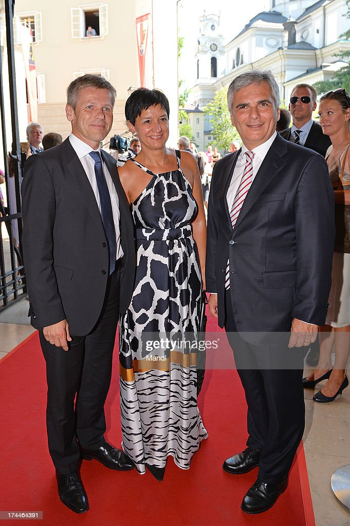 State Secretary Josef Ostermayer (L), Manuela Ostermayer and Austrian Federal Chancellor <a gi-track='captionPersonalityLinkClicked' href=/galleries/search?phrase=Werner+Faymann&family=editorial&specificpeople=4101130 ng-click='$event.stopPropagation()'>Werner Faymann</a> attend the Salzburg Festival 2013 opening ceremony on July 26, 2013 in Salzburg, Austria.