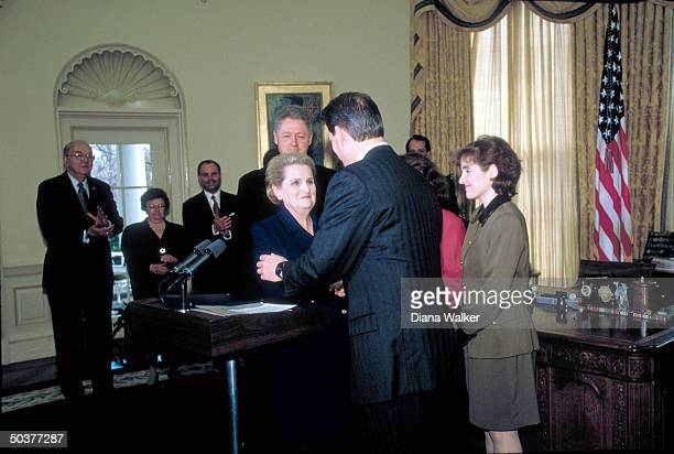 State Secy Madeleine Albright w VP Al Gore her daughter Pres Bill Clinton others during her swearin in White House Oval Office