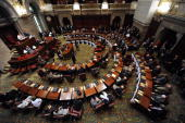 State Senators meet up in the Senate Chamber at the State Capitol Governor Paterson orders them to stay this fourth of July weekend and work on the...
