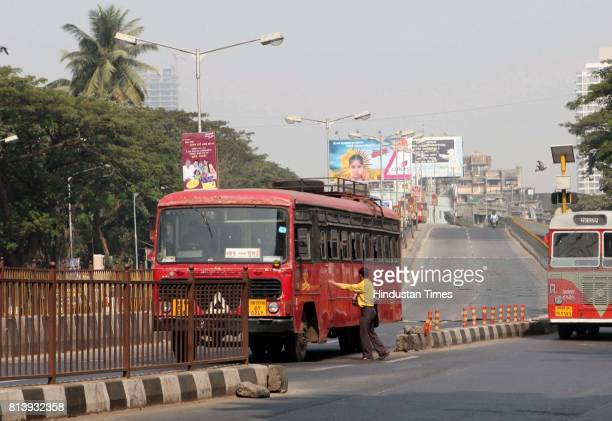 A state transport bus violates rules during road safety week by stopping for a passegner in the middle of the road