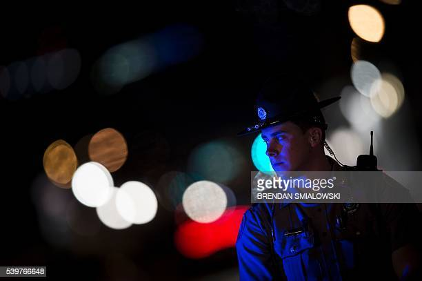A state trooper guards a side street near the Pulse nightclub on June 12 2016 in Orlando Florida People close to the gunman behind the attack on a...