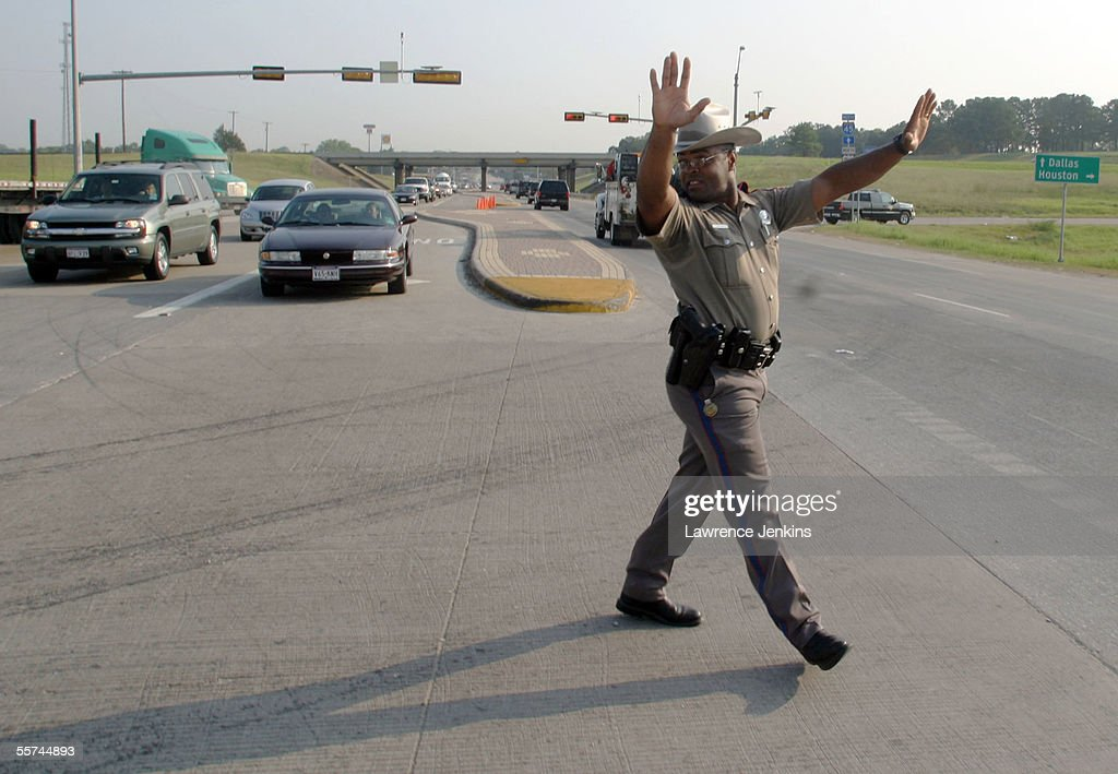 State Trooper Marvin Jenkins directs traffic that has been rerouted from I45 southbound September 22 2005 in Buffalo Texas Hurricane Rita is expected...