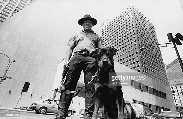 A State Trooper with dog in Lower Manhattan New York City circa 1975