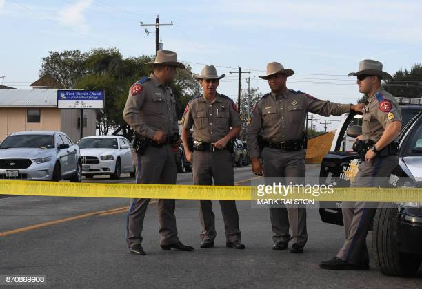 State troopers guard the entrance to the First Baptist Church after a mass shooting that killed 26 people in Sutherland Springs Texas on November 6...