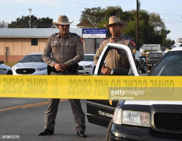 TOPSHOT State troopers guard the entrance to the First Baptist Church after a mass shooting that killed 26 people in Sutherland Springs Texas on...