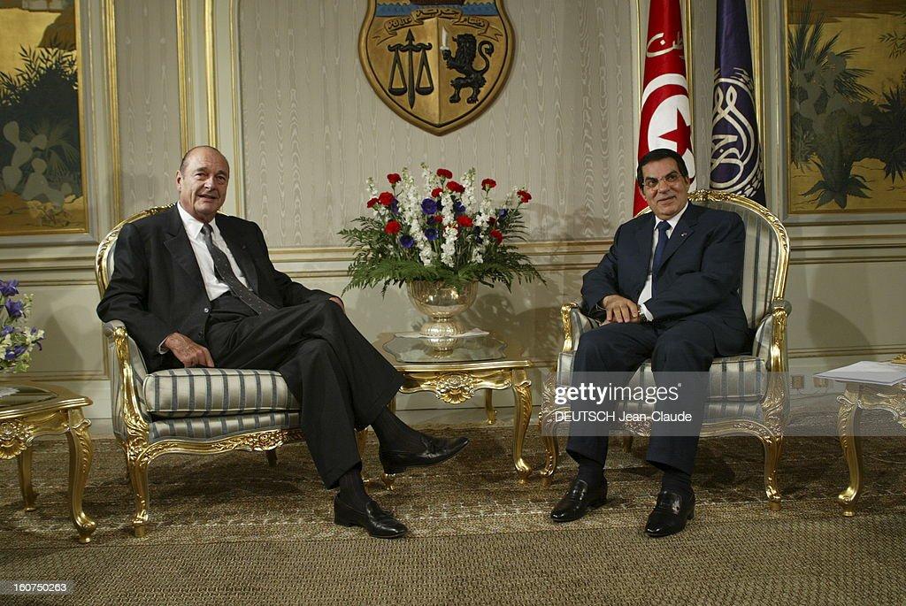 State Visit Of <a gi-track='captionPersonalityLinkClicked' href=/galleries/search?phrase=Jacques+Chirac&family=editorial&specificpeople=165237 ng-click='$event.stopPropagation()'>Jacques Chirac</a> In Tunisia. Visite officielle de Jacques CHIRAC en Tunisie 3-4 décembre 2003 : Carthage, palais présidentiel, 4 décembre : le président CHIRAC assis dans un salon avec son homologue tunisien Zine El-Abidine BEN ALI.