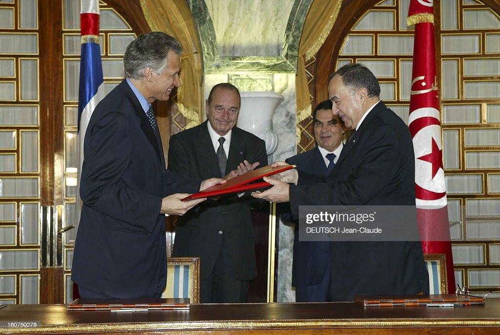 State Visit Of <a gi-track='captionPersonalityLinkClicked' href=/galleries/search?phrase=Jacques+Chirac&family=editorial&specificpeople=165237 ng-click='$event.stopPropagation()'>Jacques Chirac</a> In Tunisia. Visite officielle de Jacques CHIRAC en Tunisie 3-4 décembre 2003 : le président CHIRAC au côté de son homologue tunisien Zine El-Abidine BEN ALI à l'occasion de la signature d'un accord franco-tunision entre le ministre français des Affaires étrangères Dominique DE VILLEPIN et son homologue Habib BEN YAHIA.