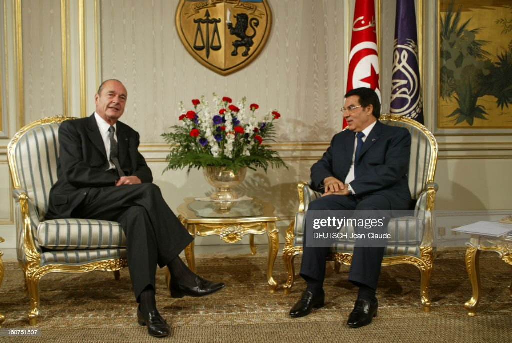 State Visit Of <a gi-track='captionPersonalityLinkClicked' href=/galleries/search?phrase=Jacques+Chirac&family=editorial&specificpeople=165237 ng-click='$event.stopPropagation()'>Jacques Chirac</a> In Tunisia. Visite officielle de Jacques CHIRAC en Tunisie 3-4 décembre 2003 : Carthage, palais présidentiel, 4 décembre : le président CHIRAC assis dans un salon avec son homologue tunisien Zine El-Abidine BEN