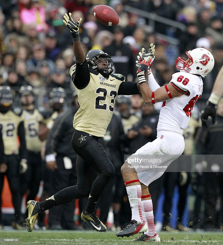 N.C. State wide receiver Quintin Payton (88) and Vanderbilt defensive back Andre Hal (23) battle for a pass during the second half of the Franklin American Mortgage Music City Bowl at LP Field in Nashville, Tennessee, Monday, December 31, 2012. The Vanderbilt Commodores defeated the N.C. State Wolfpack, 38-24.