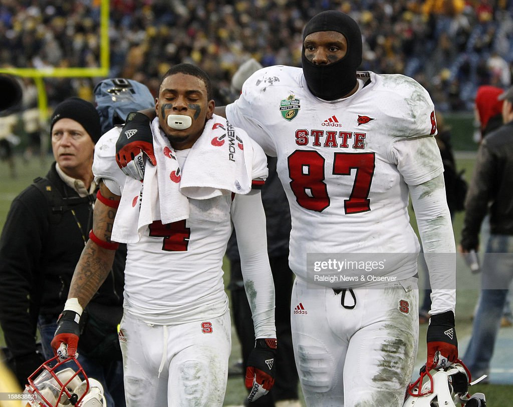 N.C. State wide receiver Tobais Palmer (4) and tight end Mario Carter (87) walk off the field after N.C. State's 38-24 loss to Vanderbilt in the Franklin American Mortgage Music City Bowl at LP Field in Nashville, Tennessee, Monday, December 31, 2012.
