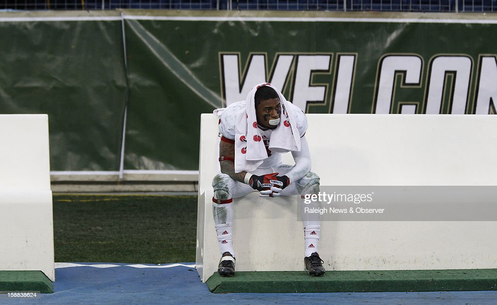 N.C. State wide receiver Tobais Palmer (4) sits on the bench after N.C. State's 38-24 loss to Vanderbilt in the Franklin American Mortgage Music City Bowl at LP Field in Nashville, Tennessee, Monday, December 31, 2012.