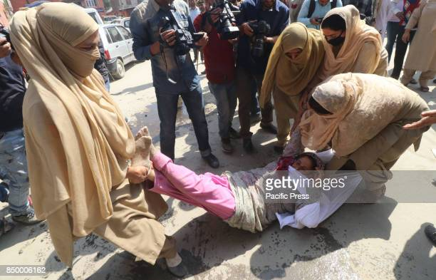 State women police dragging Anganwari workers during a demonstrating in Srinagar Indian Controlled Kashmir Anganwari workers on hunger strike from...