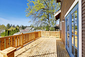 Spacious sunny walk out deck with nice view. This historic Craftsman home was designed and constructed by Henry Schneider.