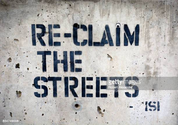 A statement stencilpainted on a concrete wall in Santa Fe New Mexico by Reclaim the Streets a movement whose members share an ideal of community...