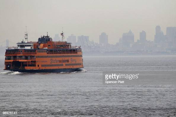 Staten Island Ferry heads towards Manhattan following the crash of another ferry into a dock in the city's borough of Staten Island on May 8 2010 in...
