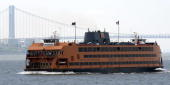 A Staten Island Ferry sails north toward Manhattan May 8 2010 near Staten Island New York Earlier on May 8 another ferry crashed into a pier at the...