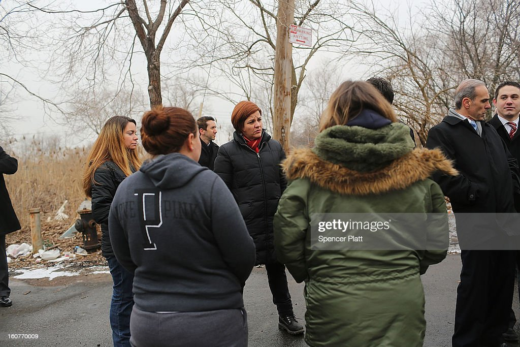 Staten Island residents and members of an Oakwood Beach homeowners association speak with City Council Speaker <a gi-track='captionPersonalityLinkClicked' href=/galleries/search?phrase=Christine+Quinn&family=editorial&specificpeople=550180 ng-click='$event.stopPropagation()'>Christine Quinn</a> in their heavily flood damaged neighborhood on February 5, 2013 in New York City. In a program proposed by New York Governor Andrew Cuomo, New York state could spend up to $400 million to buy out home owners whose properties were destroyed by Superstorm Sandy. The $50.5 billion disaster relief package, which was passed by Congress last month, would be used to fund the program. If the program is adopted, homeowners would be relocated and their land would be left as a natural barrier to help absorb future floods waters.