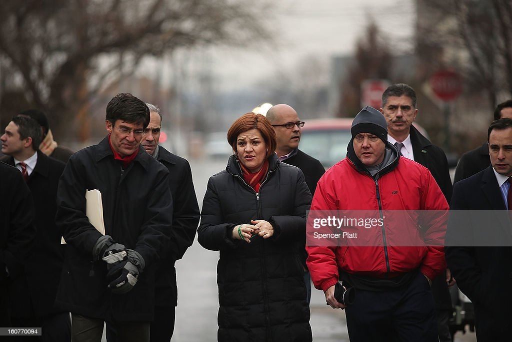 Staten Island residents and members of an Oakwood Beach homeowners association speak with City Council Speaker Christine Quinn in their heavily flood damaged neighborhood on February 5, 2013 in New York City. In a program proposed by New York Governor Andrew Cuomo, New York state could spend up to $400 million to buy out home owners whose properties were destroyed by Superstorm Sandy. The $50.5 billion disaster relief package, which was passed by Congress last month, would be used to fund the program. If the program is adopted, homeowners would be relocated and their land would be left as a natural barrier to help absorb future floods waters.