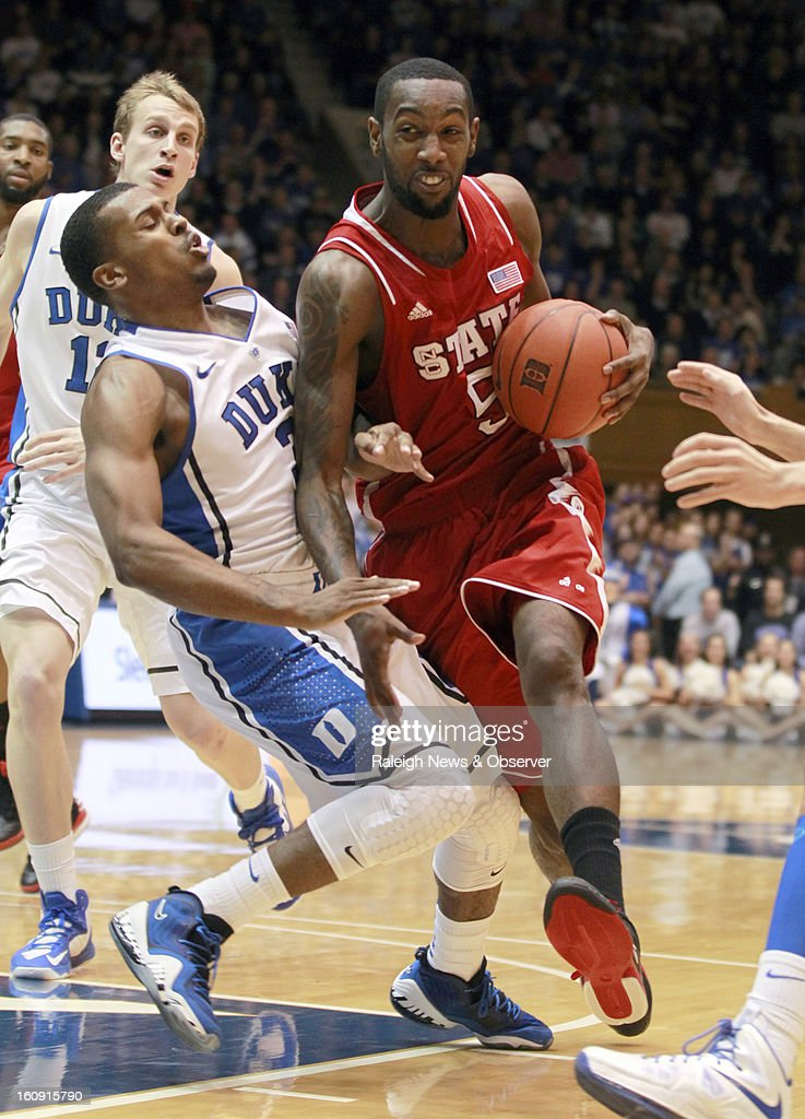 N.C. State's C.J. Leslie (5) drives around Duke's Tyler Thornton (3) during the first half of a men's college basketball game against Duke at Cameron Indoor Stadium in Durham, North Carolina, Thursday, February 7, 2013.