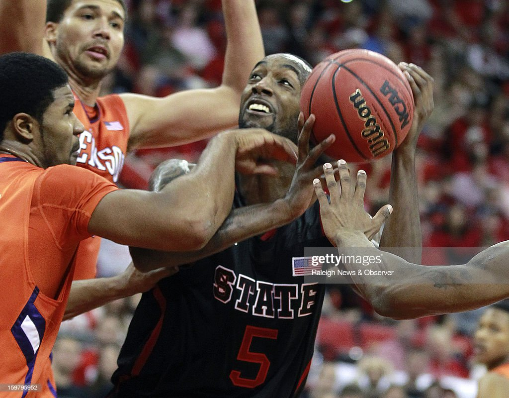 N.C. State's C.J. Leslie (5) is surrounded by Clemson defenders, including Devin Booker (31), left, and Adonis Filer (3), right, during the first half of a men's college basketball game at PNC Arena on Sunday, January 20, 2013, in Raleigh, North Carolina.