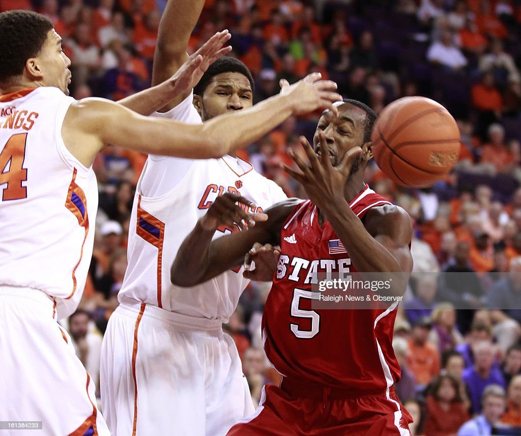 N.C. State's C.J. Leslie (5) loses the ball as Clemson's Milton Jennings (24), left, and Devin Booker (31) defend during the first half at Littlejohn Coliseum in Clemson, South Carolina, Sunday, February 10, 2013.