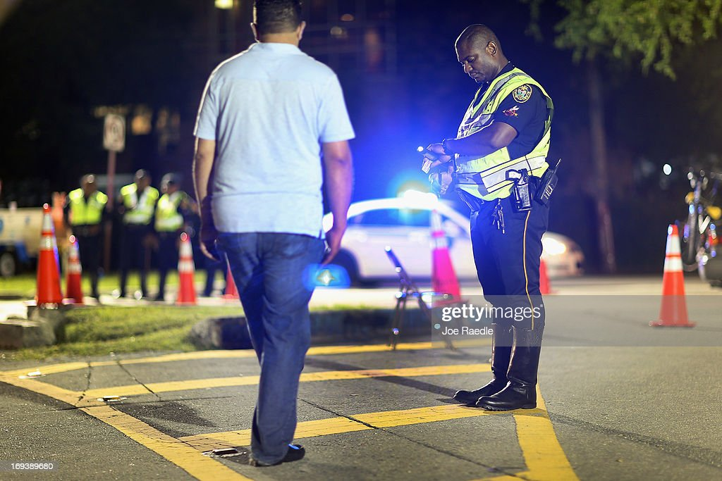 City of North Miami Beach police officer Duhamel Jeanite conducts a field sobriety test during a DUI checkpoint on May 23 2013 in Miami Florida The...