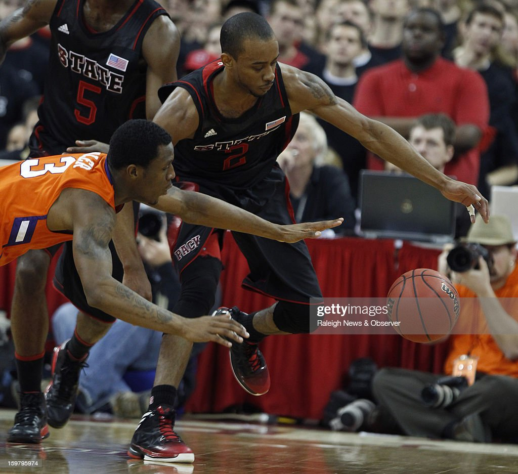 N.C. State's Lorenzo Brown (2) beats Clemson's Adonis Filer (3) to the ball during the first half of a men's college basketball game at PNC Arena on Sunday, January 20, 2013, in Raleigh, North Carolina.