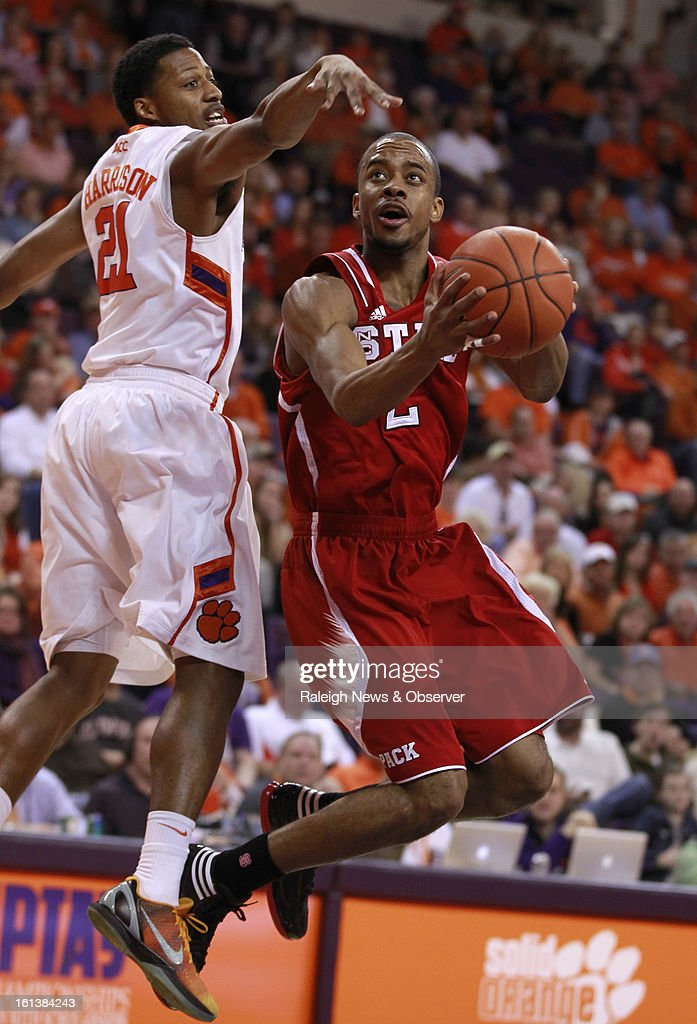N.C. State's Lorenzo Brown (2) drives to the basket against Clemson's Damarcus Harrison (21) during the first half at Littlejohn Coliseum in Clemson, South Carolina, Sunday, February 10, 2013.