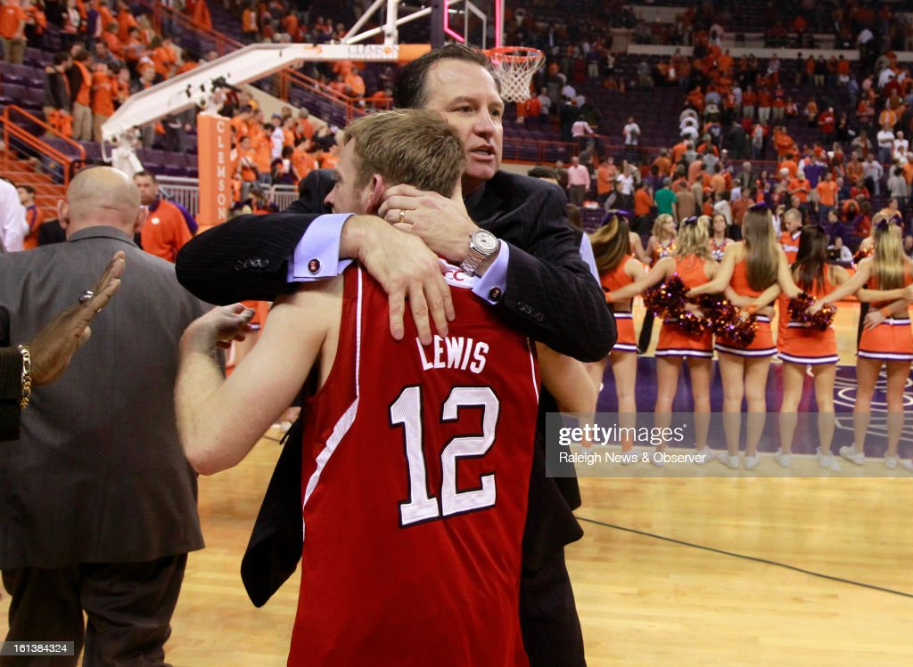 N.C. State's Mark Gottfried congratulates N.C. State's Tyler Lewis (12) at the end of the game at Littlejohn Coliseum in Clemson, South Carolina, Sunday, February 10, 2013. N.C. State won, 58-57.