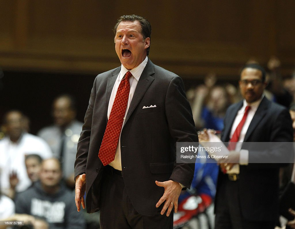 N.C. State's Mark Gottfried yells to his team during the first half of a men's college basketball game against Duke at Cameron Indoor Stadium in Durham, North Carolina, Thursday, February 7, 2013.