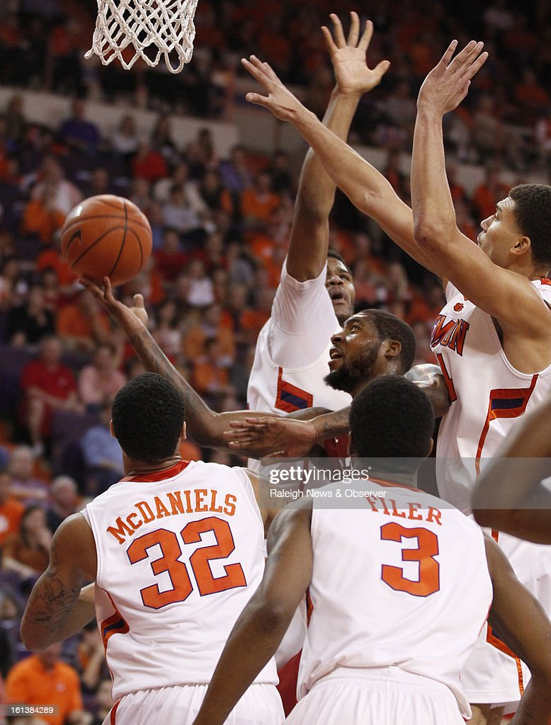 N.C. State's Richard Howell (1) puts up a shot against Clemson's Devin Booker (31), Milton Jennings (24), K.J. McDaniels (32) and Adonis Filer (3) during the second half at Littlejohn Coliseum in Clemson, South Carolina, Sunday, February 10, 2013. N.C. State won, 58-57.