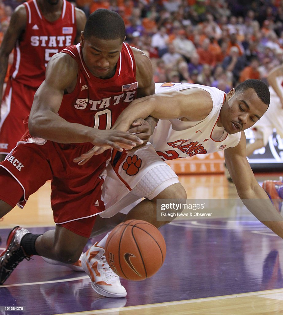 N.C. State's Rodney Purvis (0) and Clemson's Bernard Sullivan (22) fight for the loose ball during the first half at Littlejohn Coliseum in Clemson, South Carolina, Sunday, February 10, 2013.
