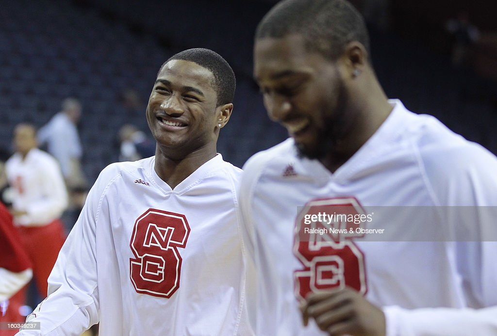 N.C. State's Rodney Purvis (0), left, laughs with Richard Howell (1) before the Wolfpack's game against the Virginia Cavaliers, at John Paul Jones Arena in Charlottesville, Virginia, Tuesday, January 29, 201.
