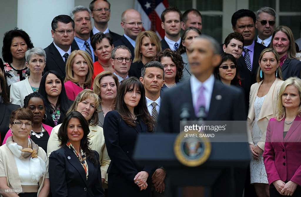 States Teachers of the Year listen as US President <a gi-track='captionPersonalityLinkClicked' href=/galleries/search?phrase=Barack+Obama&family=editorial&specificpeople=203260 ng-click='$event.stopPropagation()'>Barack Obama</a> speaks during a ceremony in the Rose Garden at the White House in Washington on April 23, 2013. AFP PHOTO/Jewel Samad