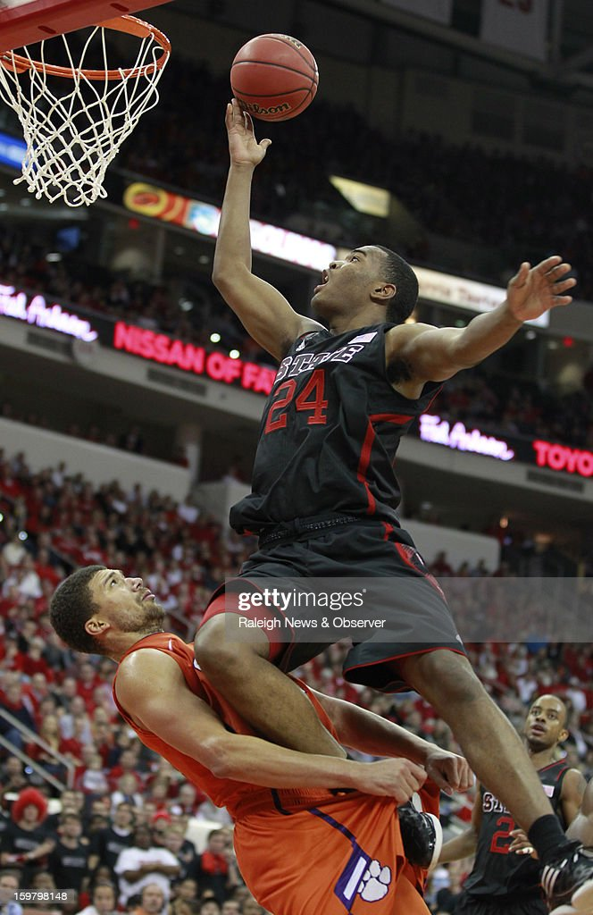 N.C. State's T.J. Warren (24) is fouled by Clemson's Milton Jennings (24) during the second half of the Wolfpack's 66-62 victory over the Tigers at PNC Arena on Sunday, January 20, 2013, in Raleigh, North Carolina.