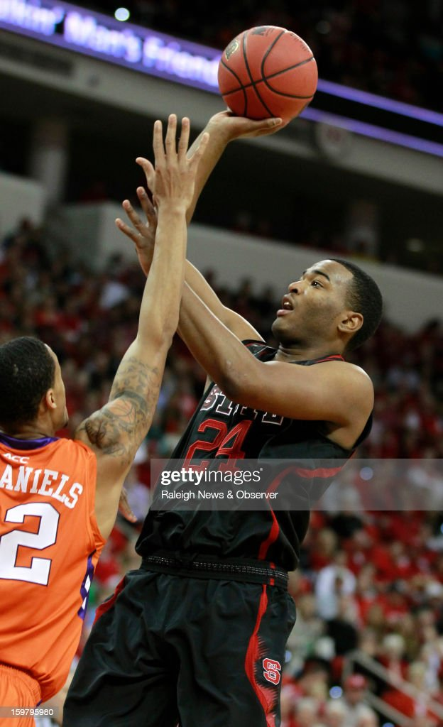 N.C. State's T.J. Warren (24) shoots over Clemson's K.J. McDaniels (32) during the first half of a men's college basketball game at PNC Arena on Sunday, January 20, 2013, in Raleigh, North Carolina.