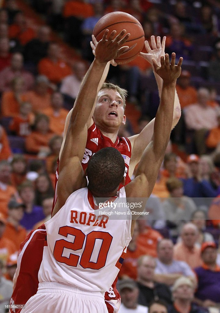 N.C. State's Tyler Lewis (12) shoots over Clemson's Jordan Roper (20) during the first half at Littlejohn Coliseum in Clemson, South Carolina, Sunday, February 10, 2013.