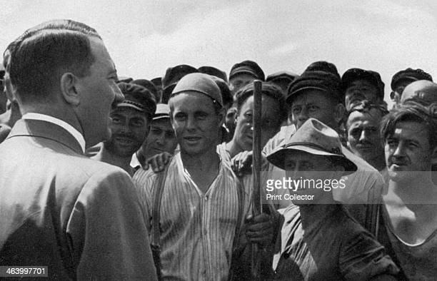 'A statesman moves among the workers' Germany 1936 German Nazi leader Adolf Hitler meeting industrial workers A print from Adolf Hitler Bilder aus...