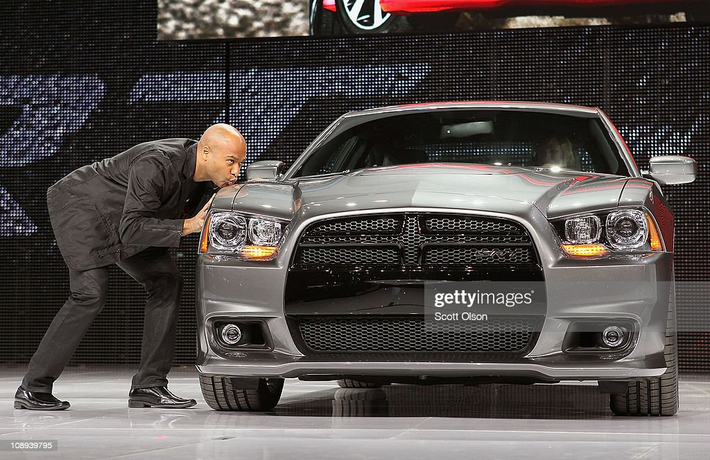Stating he loves the car and can't wait for his own, President and CEO of Dodge Brand Ralph Gilles kisses the fender of Dodge's new 2012 Charger SRT8 during the car's introduction at the Chicago Auto Show on February 9, 2011 in Chicago, Illinois. The show opened for media previews today. It is open to the general public February 11.