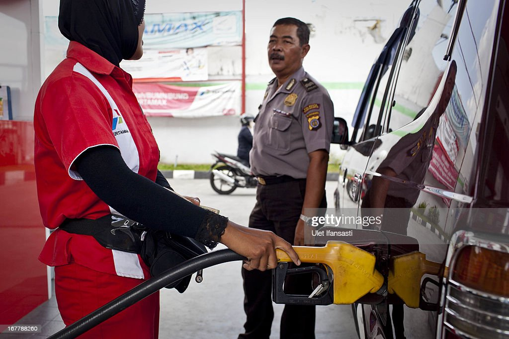 A station attendant refuels a car at a fuel station on April 30, 2013 in Yogyakarta, Indonesia. The Indonesian government is considering raising fuel prices for all vehicle types in an attempt to free up funds for infrastructure and spur growth.