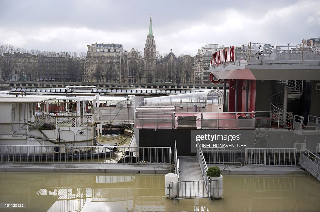 A station of the 'Bateaux-Mouches' riverboat company is pictured along partially submerged banks of the river Seine on February 9, 2013 in Paris, as the river Seine's level rose in Paris. Roads along the river are closed to motorists since February 6 after the level of the water was reported at 3,79 meters high instead of the usual 2 meters.