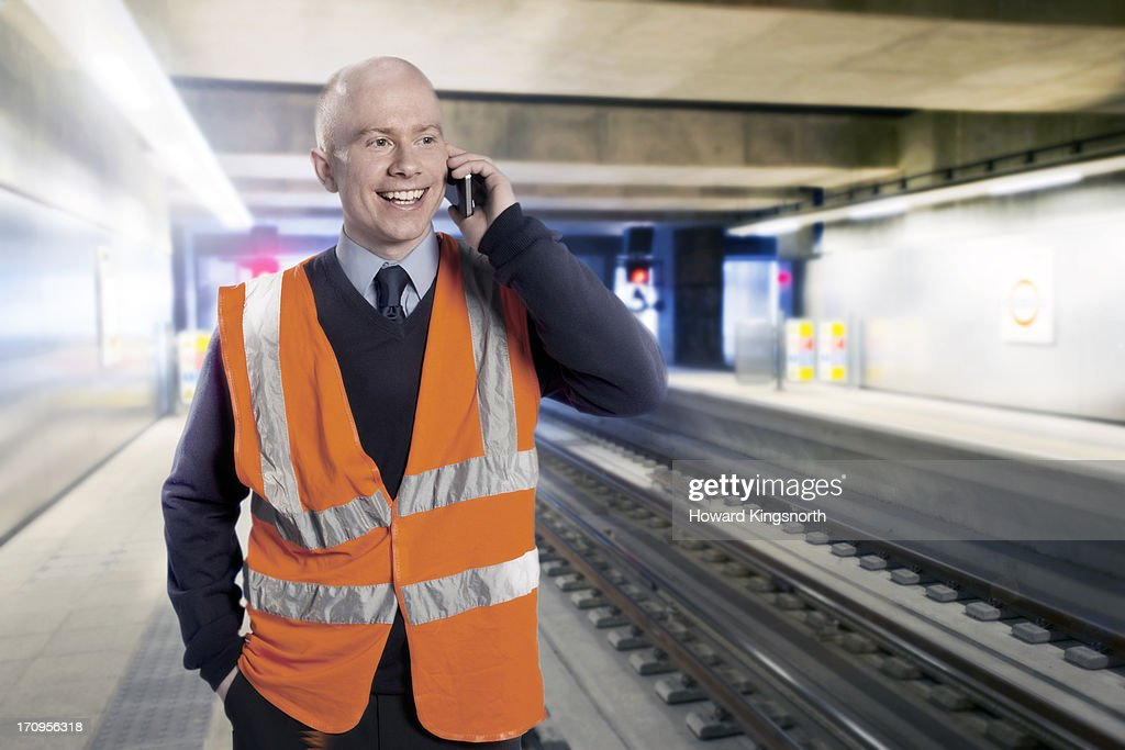 station workman on cellphone : Stock Photo