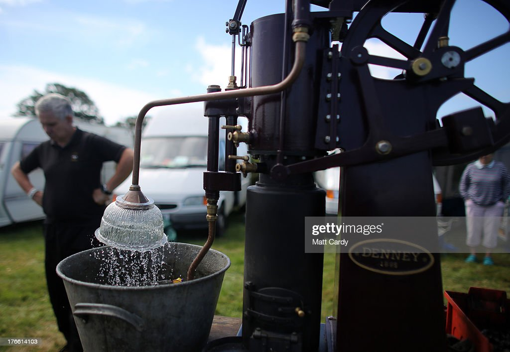 A stationary engine is shown at the Cornish Steam and Country Fair at the Stithians Showground on August 16, 2013 near Penryn, England. The annual show, now in 58th year, is one of Cornwall's largest outdoor events and is one of the UK's most popular and respected steam rallies.